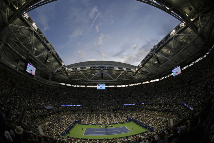 Naomi Osaka, left on court, of Japan, takes on Coco Gauff, of the United States, during the third round of the U.S. Open tennis tournament Saturday, Aug. 31, 2019, in New York. AP