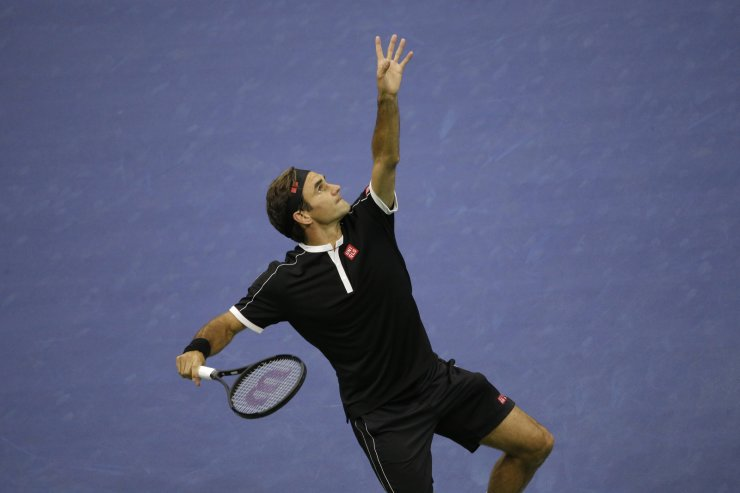 Roger Federer, of Switzerland, serves to Grigor Dimitrov, of Bulgaria, during the quarterfinals of the U.S. Open tennis tournament, Tuesday, Sept. 3, 2019, in New York. AP