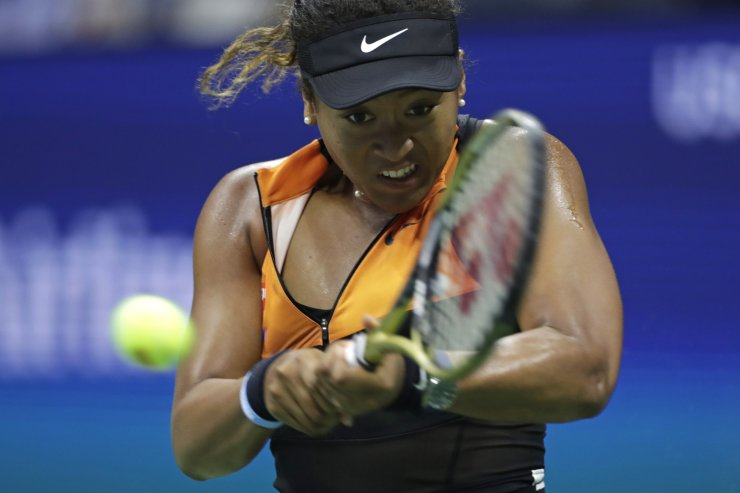 Naomi Osaka, of Japan, returns a shot to Coco Gauff, of the United States, during the third round of the U.S. Open tennis tournament Saturday, Aug. 31, 2019, in New York. AP