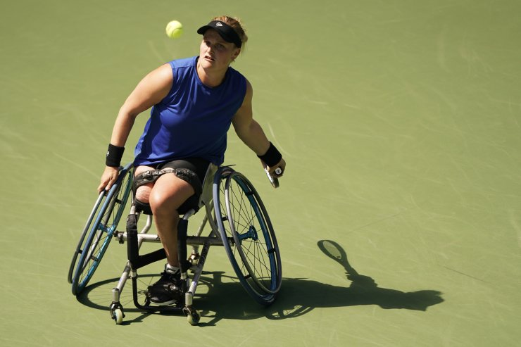 Aniek Van Koot, of the Netherlands, returns a shot to Yui Kamiji, of Japan, during the women's singles wheelchair quarterfinals of the U.S. Open tennis championships Saturday, Sept. 7, 2019, in New York. AP