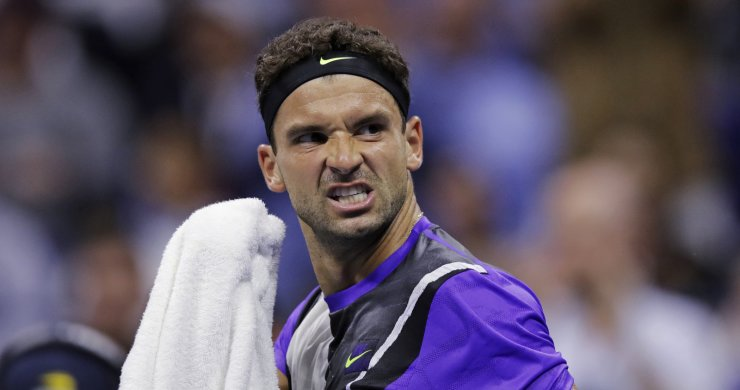Grigor Dimitrov, of Bulgaria, reacts after winning the fourth set against Roger Federer, of Switzerland, during the quarterfinals of the U.S. Open tennis tournament Tuesday, Sept. 3, 2019, in New York. AP