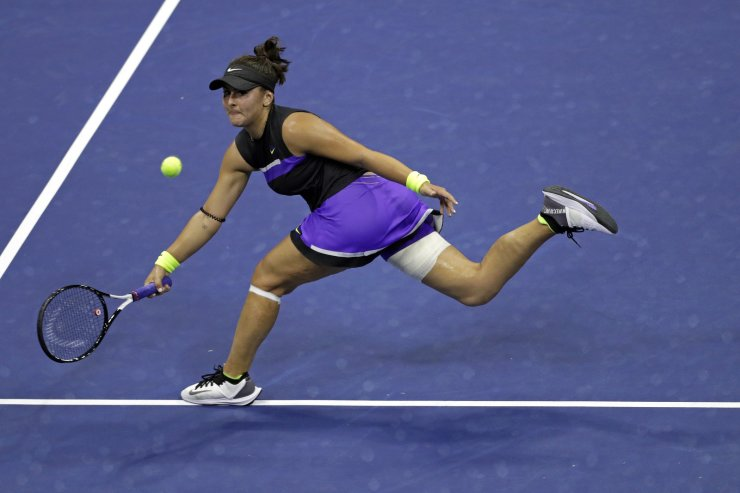 Bianca Andreescu, of Canada, runs down a shot from Elise Mertens, of Belgium, during the quarterfinals of the U.S. Open tennis tournament Wednesday, Sept. 4, 2019, in New York. AP