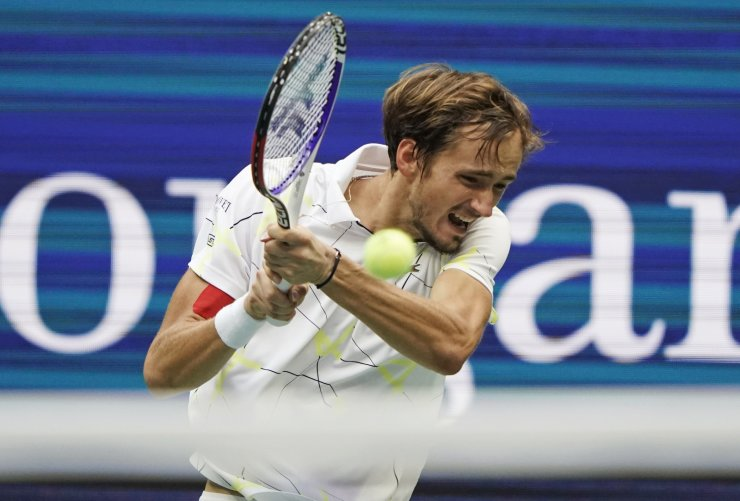 Daniil Medvedev, of Russia, returns a shot to Rafael Nadal, of Spain, during the men's singles final of the U.S. Open tennis championships Sunday, Sept. 8, 2019, in New York. AP