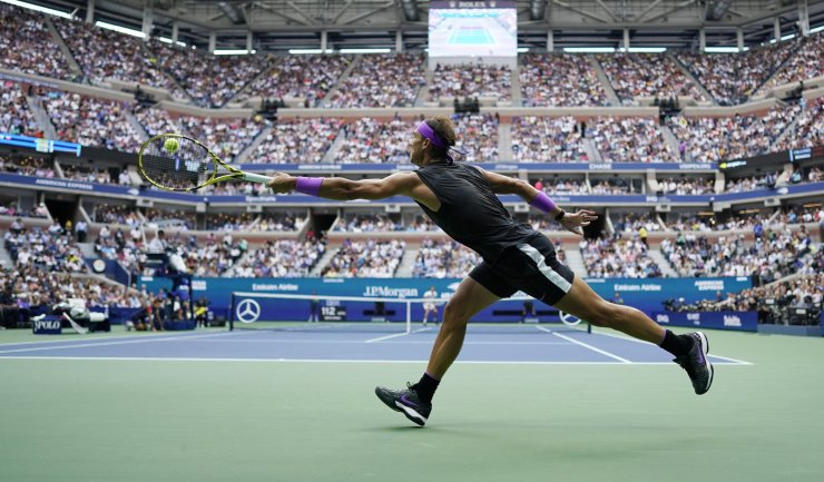Rafael Nadal, of Spain, returns a shot to Daniil Medvedev, of Russia, during the men's singles final of the U.S. Open tennis championships Sunday, Sept. 8, 2019, in New York. AP