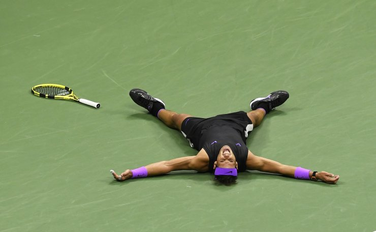 Rafael Nadal, of Spain, reacts after defeating Daniil Medvedev, of Russia, to win the men's singles final of the U.S. Open tennis championships Sunday, Sept. 8, 2019, in New York. AP