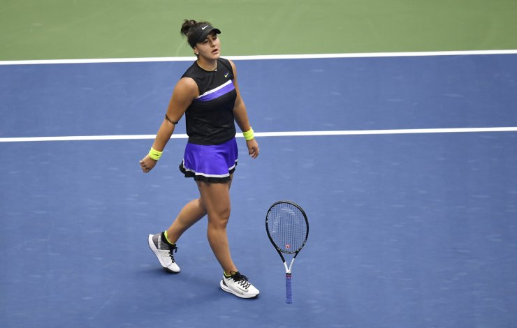 Bianca Andreescu, of Canada, drops her racket after defeating Serena Williams, of the United States, in the women's singles final of the U.S. Open tennis championships Saturday, Sept. 7, 2019, in New York. AP