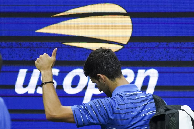 Novak Djokovic, of Serbia, walks off the court as he retires during his match against Stan Wawrinka, of Switzerland, during the fourth round of the U.S. Open tennis championships, Sunday, Sept. 1, 2019, in New York. AP