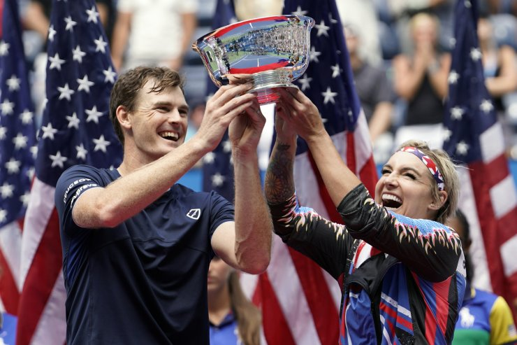 Jamie Murray, of the United Kingdom, left, and Bethanie Mattek-Sands, of the United States, hold up the championship trophy after winning the mixed doubles final against Hao-Ching Chan, of Taiwan, and Michael Venus, of New Zealand, at the U.S. Open tennis championships Saturday, Sept. 7, 2019, in New York. AP