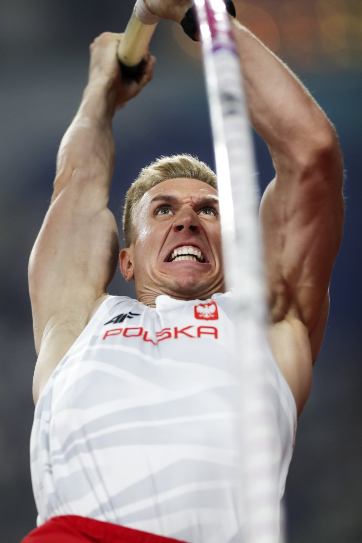 Piotr Lisek, of Poland, competes in the men's pole vault final at the World Athletics Championships in Doha, Qatar, Tuesday, Oct. 1, 2019. AP