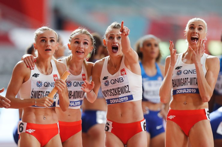 (From L to R) Poland's Justyna Swiety-Ersetic, Poland's Malgorzata Holub-Kowalik, Poland's Patrycja Wyciszkiewicz and Poland's Iga Baumgart-Witan react after finishing second in the Women's 4x400m Relay final at the 2019 IAAF Athletics World Championships at the Khalifa International stadium in Doha on October 6, 2019. AFP