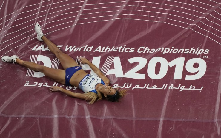 Katarina Johnson-Thompson, of Great Britain, lays on the mat after hitting the bar during the high jump in the women's heptathlon at the World Athletics Championships in Doha, Qatar, Wednesday, Oct. 2, 2019. AP