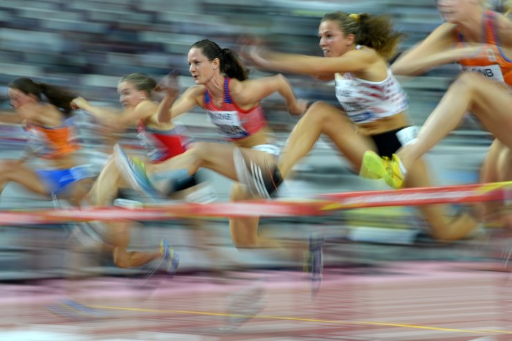 Czech Republic's Katerina Cachova (C) competes in the Women's 100m Hurdles Heptathlon heats at the 2019 IAAF Athletics World Championships at the Khalifa International stadium in Doha on October 2, 2019. AFP