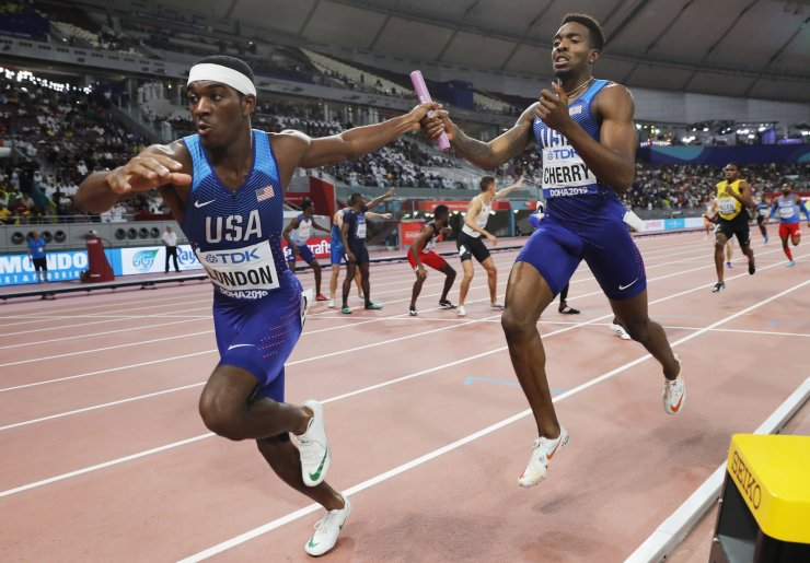 Michael Cherry (R) of the USA hands over the baton to Wilbert London during the men's 4x400m Relay final at the IAAF World Athletics Championships 2019 at the Khalifa Stadium in Doha, Qatar, 06 October 2019. EPA