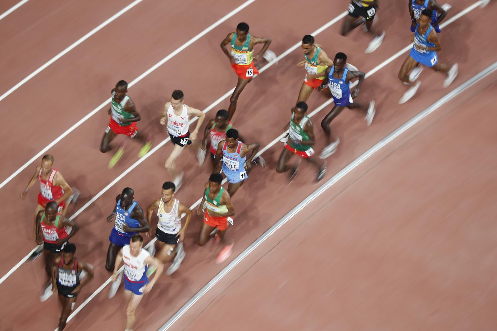Athletics - World Athletics Championships - Doha 2019 - Men's 10,000 Metres Final - Khalifa International Stadium, Doha, Qatar - October 6, 2019 Ethiopia's Yomif Kejelcha, Switzerland's Julien Wanders and Eritrea's Aron Kifle in action REUTERS