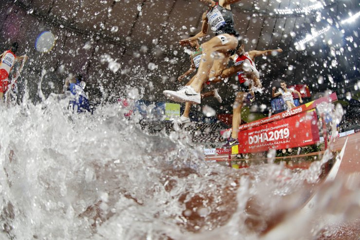 Runners compete in the first round of the men's 3000 steeplechase at the World Athletics Championships in Doha, Qatar, Tuesday, Oct. 1, 2019. AP
