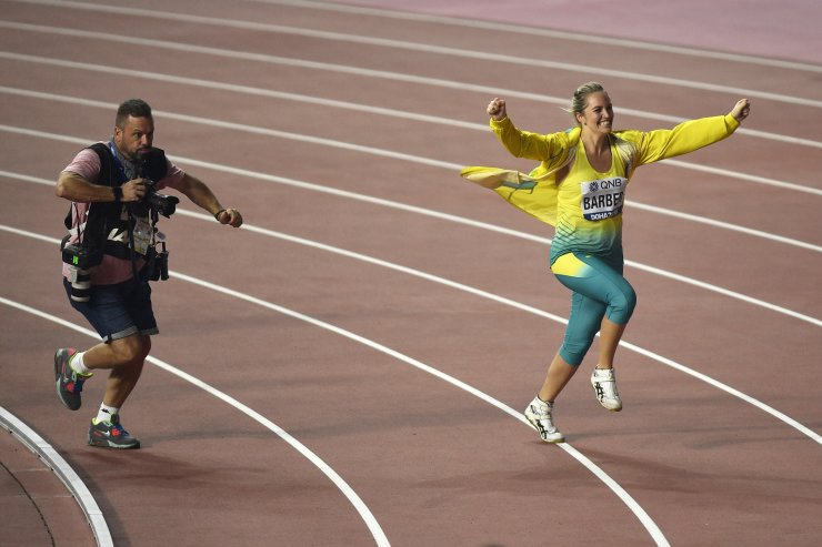 Kelsey-Lee Barber, of Australia, celebrates winning a gold medal in the women's javelin throw final at the World Athletics Championships in Doha, Qatar, Tuesday, Oct. 1, 2019. AP