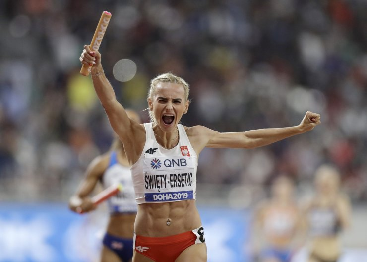 Poland's Justyna Swiety-Ersetic celebrates as she crosses the finish line to lead the team to silver in the women's 4x400 meter relay final at the World Athletics Championships in Doha, Qatar, Sunday, Oct. 6, 2019. AP