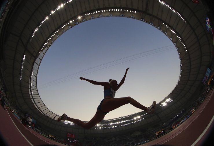 Kristiina Mäkelä, of Finland, competes in the women's triple jump qualifications at the World Athletics Championships in Doha, Qatar, Thursday, Oct. 3, 2019. AP
