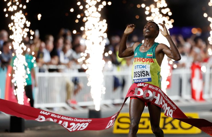 Lelisa Desisa of Ethiopia crosses the finish line during the Men's Marathon at the 2019 IAAF World Athletics Championships in Doha, Qatar, Oct. 5, 2019. Xinhua