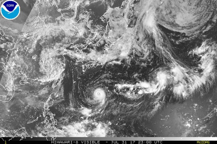 This satellite image taken July 31 and released by the National Oceanic and Atmospheric Administration shows Typhoon Noru. / AP-Yonhap