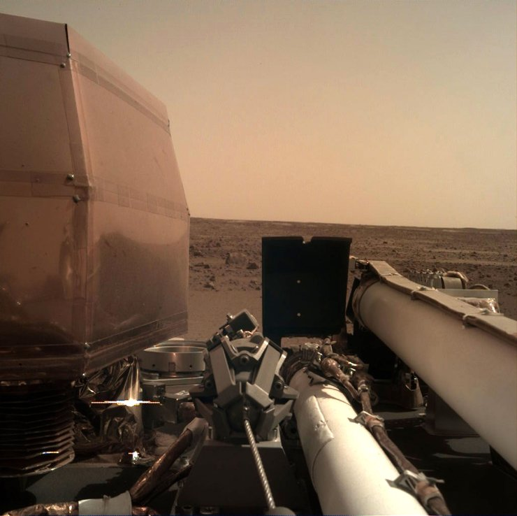 This handout image released by NASA/JPL-Caltech on November 26, 2018 and acquired by NASA's InSight Mars lander using its robotic arm-mounted, Instrument Deployment Camera (IDC) shows a view from NASA's InSight lander after it touched down on the surface of Mars. AFP