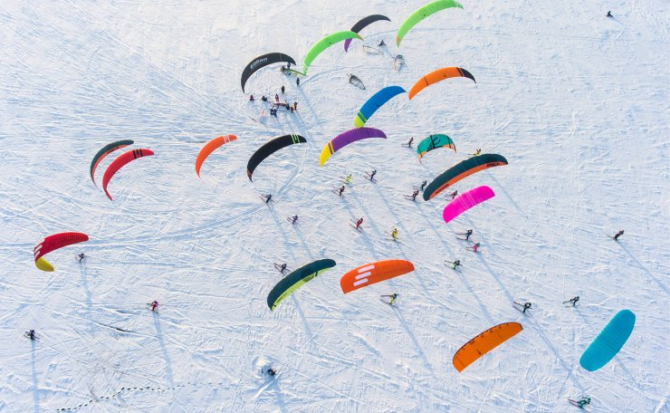 Participants in the 2018 Siberian Snowkiting Cup compete on the surface of the Novosibirsk Reservoir near the Novosibirsk hydroelectric power plant. TASS