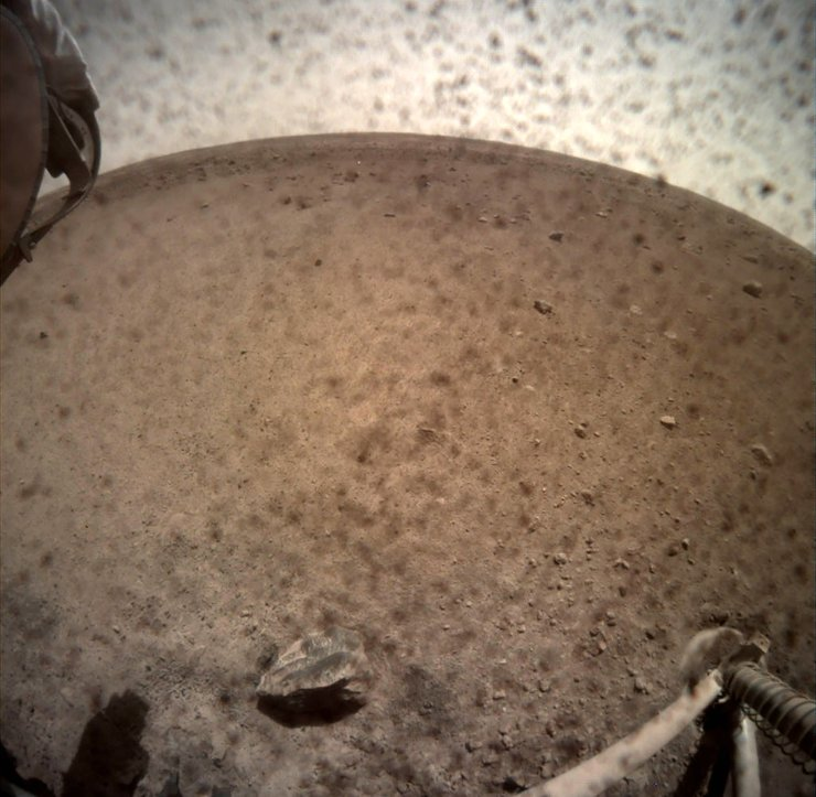 An image acquired by NASA's InSight Mars lander shows the area in front of the lander using its lander-mounted, Instrument Context Camera (ICC) on Mars November 30, 2018. Image acquired November 30, 2018. Reuters