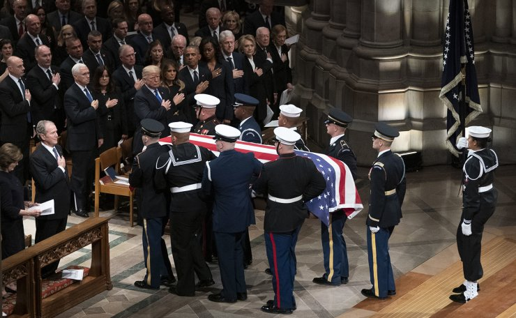 The flag-draped casket of former President George H.W. Bush is carried by a military honor guard past former President George W. Bush and his wife Laura Bush , President Donald Trump, first lady Melania Trump, former President Barack Obama, Michelle Obama, former President Bill Clinton, former Secretary of State Hillary Clinton, former President Jimmy Carter, and Rosalynn Carter at the conclusion of a State Funeral at the National Cathedral, Wednesday, Dec. 5, 2018, in Washington. AP