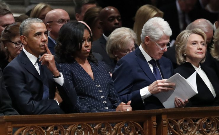 Former President Barack Obama, Michelle Obama, former President Bill Clinton and former Secretary of State Hillary Clinton listen during the State Funeral for former President George H.W. Bush at the National Cathedral, Wednesday, Dec. 5, 2018, in Washington. AP