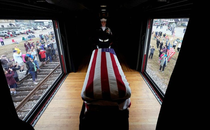 People pay their respects as the train carrying the casket of former President George H.W. Bush passes Thursday, Dec. 6, 2018, along the route from Spring to College Station, Texas. Reuters