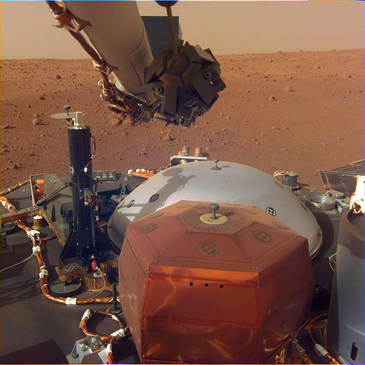 <span>In this image obtained from NASA, InSight's robotic-arm mounted Instrument Deployment Camera shows the instruments on the spacecraft's deck, with the Martian surface of Elysium Planitia in the background. The color-calibrated picture was acquired on December 4, 2018 - Humans can now hear the haunting, low rumble of wind on Mars for the first time, after NASA's InSight lander captured vibrations from the breeze on the Red Planet, the US space agency said on December 7, 2018. The strong gusts of wind, blowing between 10 to 15 mph (five to seven meters a second), were captured as they moved over the solar panels on InSight, an unmanned lander that touched down on Earth's dusty, desolate neighbor November 26. AFP</span><br /><br />