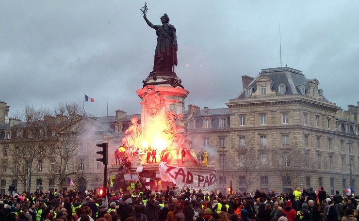 French anti-government protestors set alight a flare on the statue of Marianne, symbol of the Republic, in Paris December 8, 2018. Violence erupted with security forces after more than 30,000 'yellow vest' demonstrators took to the streets of the capital. UPI