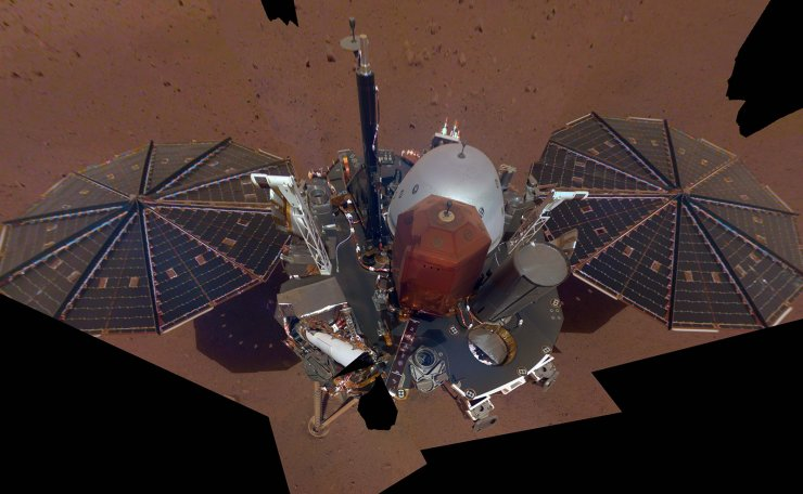 A handout photo made available by NASA/JPL-Caltech on 11 December 2018 shows NASA InSight's first full selfie on Mars. It displays the lander's solar panels and deck. On top of the deck are its science instruments, weather sensor booms and UHF antenna. The selfie is made up of 11 images which were taken by its Instrument Deployment Camera, located on the elbow of its robotic arm. Those images are then stitched together into a mosaic. EPA