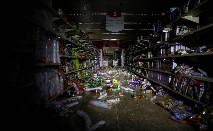 Damage is seen in a supermarket after it was looted during an ongoing blackout in Caracas, Venezuela March 10, 2019. Reuters