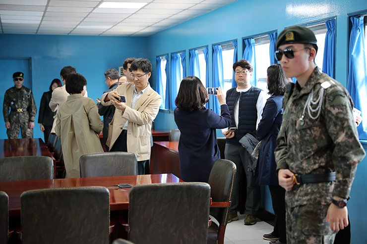 South Korean visitors take their souvenir photos at the southern side of Panmunjom in the Demilitarized Zone, South Korea, Wednesday, May 1, 2019. Joint Press Corps