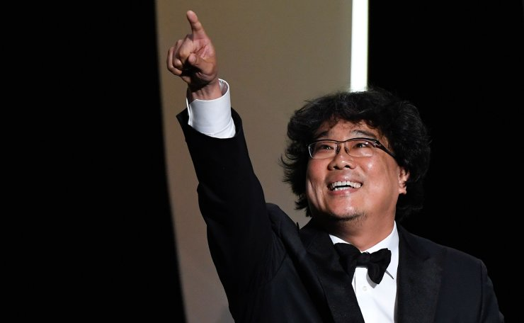 South Korean director Bong Joon-Ho reacts on stage after he was awarded with the Palme d'Or for the film 'Parasite (Gisaengchung)' on May 25, 2019 during the closing ceremony of the 72nd edition of the Cannes Film Festival in Cannes, southern France. AFP
