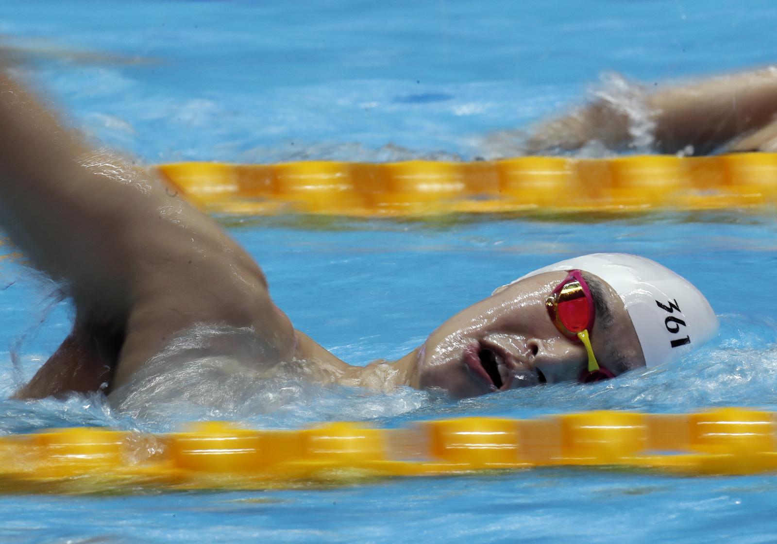 China's Sun Yang swims during a training session at the World Swimming Championships in Gwangju, South Korea, Saturday, July 20, 2019. AP