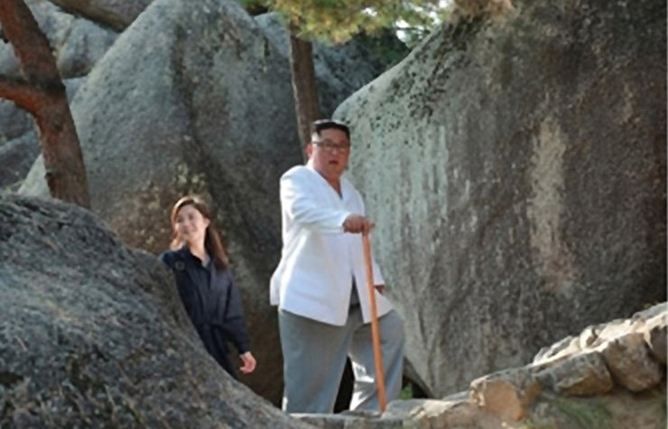 Ri Sol-ju is seen in this photo released on Wednesday by the North's official Korean Central News Agency (KCNA) accompanying Kim Jong-un on his 'field guidance' trip to the Mount Kumgang resort on the country's scenic east coast. Yonhap