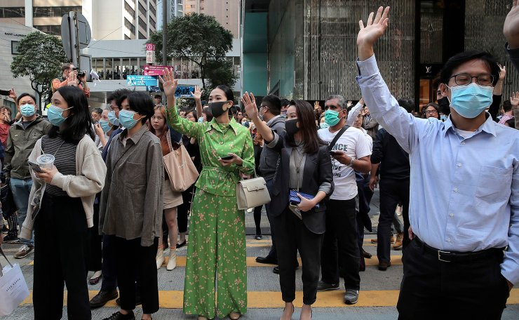 Protesters hold up their hands to symbolize pro-democracy demonstrators' five demands during a demonstration in the financial district in Hong Kong, Wednesday, Nov. 20, 2019. AP