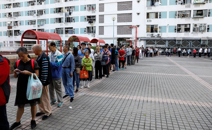 Voters queue outside a polling station during district council local elections in Hong Kong, China November 24, 2019. Reuters