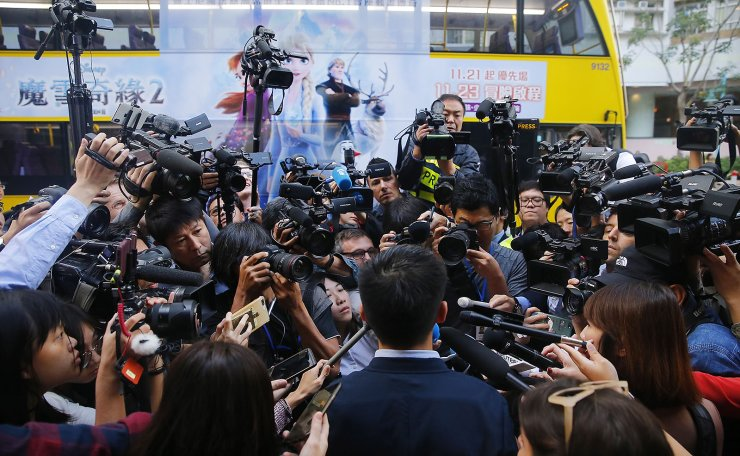 Pro-democracy activist and leader Joshua Wong (C), talks to media as he arrives to cast vote for the District Council Ordinary Election in Hong Kong, China, 24 November 2019. On 24 November 4.13 million registered electors will cast their votes for the 2019 District Council Ordinary Election. EPA