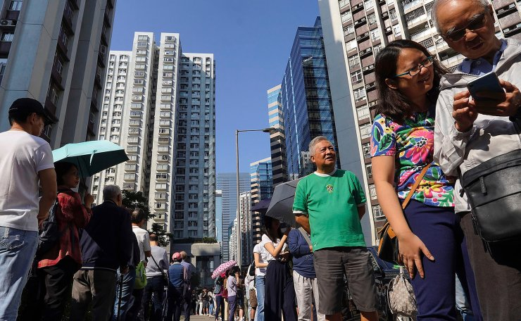 People line up to vote outside of a polling place in Hong Kong, Sunday, Nov. 24, 2019. Long lines formed outside Hong Kong polling stations Sunday in elections that have become a barometer of public support for anti-government protests now in their sixth month. AP