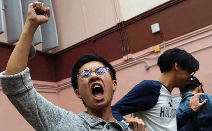 Supporters of a pro-democracy candidate cheer after winning their seat in district council elections in Hong Kong, early Monday, Nov. 25, 2019. Voters in Hong Kong turned out in droves on Sunday in district council elections seen as a barometer of public support for pro-democracy protests that have rocked the semi-autonomous Chinese territory for more than five months. AP