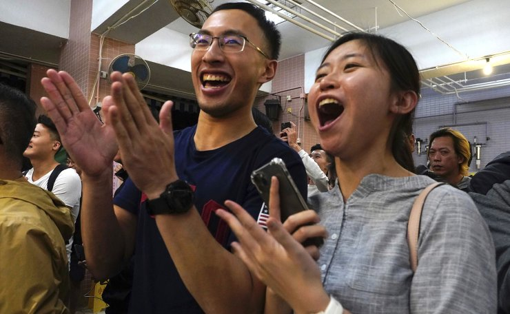 Supporters of pro-democracy candidate James Yu cheer after he won his seat in district council elections in Hong Kong, early Monday, Nov. 25, 2019. Vote counting was underway in Hong Kong on Sunday after a massive turnout in district council elections seen as a barometer of public support for pro-democracy protests that have rocked the semi-autonomous Chinese territory for more than five months. AP