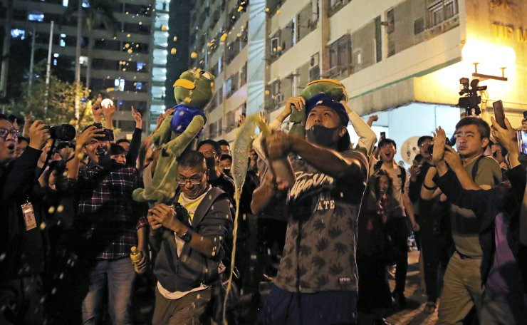 Pro-democracy supporters celebrate after pro-Beijing politician Junius Ho lost his election in Hong Kong, early Monday, Nov. 25, 2019. The pro-democracy opposition won a resounding victory in Hong Kong elections, according to media tallies, in a clear rebuke to city leader Carrie Lam and her handling of violent protests that have divided the Chinese territory. AP