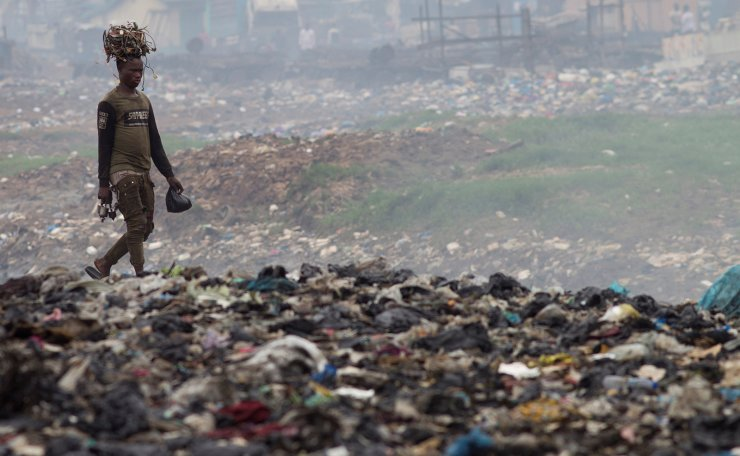 A man recovers cables from the dump of Agbogbloshie in Accra, Ghana, 12 November 2019 (Issued on 25 November 2019). The Agbogbloshie dump is considered the biggest electronic trash dump in the African continent, where the electronic trash arrives from all over the world, mainly from Europe and the US. According to the International Recycling Office, the world will generate 53.9 tons of electronic waste by 2025 if the production continues until now, which means a 3 per cent increase per year of electronic trash. The COP25 World Climate Change Conference will take place from 02 to 13 December in Madrid under the motto 'Time to Act'. EPA