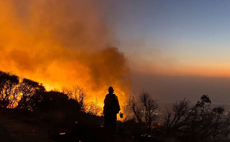 In this photo released by the Santa Barbara County Fire Department on November 25, 2019, a fire burns in Los Padres National Forest, near Painted Cave, on East Camino Cielo Road. - A wind-driven brush fire that started late Monday November 25, 2019, afternoon in Los Padres National Forest near Highway 154 in Santa Barbara County moved quickly downhill, prompting mandatory evacuations and threatening homes. The Cave fire started just after 4 p.m. near East Camino Cielo and Painted Cave Road and by 8 p.m. had grown to at least 2,500 acres, according to the Santa Barbara County Fire Department. AFP