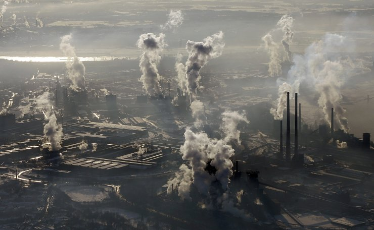 In this Jan. 9, 2009 file photo is an aerial view of the steel company ThyssenKrupp in Duisburg, western Germany. Inger Andersen, head of the U.N. Environment Program, says the world needs 'quick wins to reduce emissions as much as possible in 2020.' Ahead of a global climate summit in Madrid next week, her agency published a report Tuesday showing the amount of planet-heating gases released into the atmosphere hitting a new high last year. AP