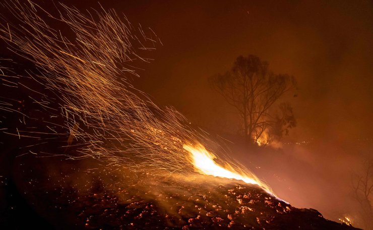 Wind blows embers as the Cave fire burns a hillside in Santa Barbara, California on November 26, 2019. AFP
