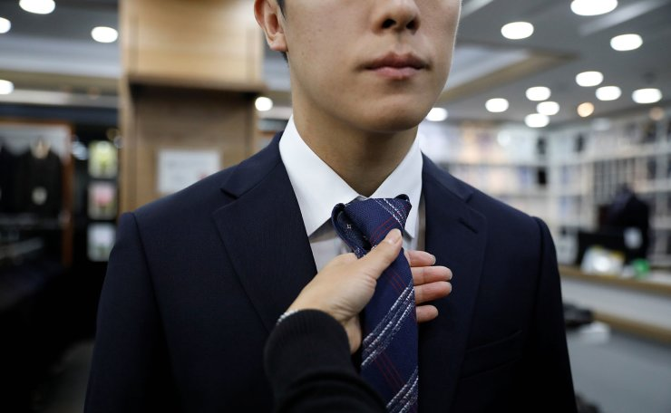 Hwang Hyeon-dong and his mother shop for a suit ahead of a job interview in Guri, South Korea, November 5, 2019. REUTERS/Kim Hong-Ji